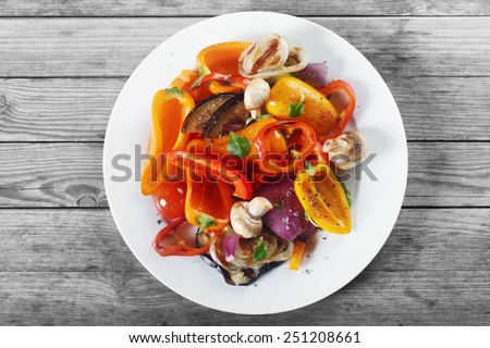 Close up Aerial Shot of Appetizing Healthy Recipe with Mushrooms and Spices on White Plate. Placed on Wooden Table.
