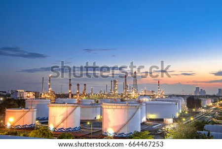 Close up Aerial view at oil and gas industrial,Oil refinery plant form industry,Refinery factory and oil storage tank with sunset
