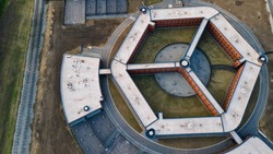 close up aerial view of a European jail or prison. Aerial view of penitentiary prison. Aerial photo of a prison.