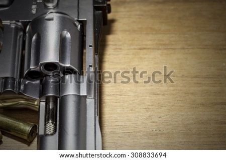 close -up air gun on old wood background