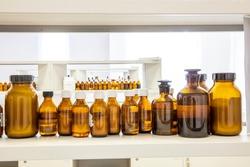 Close up amber color bottles in laboratory. Amber bottle for storing scientific samples.