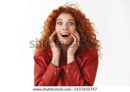 Close-up amused happy cheerful ginger girl curly hairstyle smiling pleased amazed reacting awesome good news touch cheeks stunning great lucky day winning prize joyfully grinning look surprised