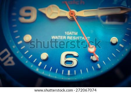 Close-up analog  hand clock  to six