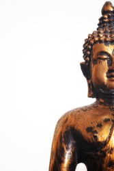 Close up and a half of statue of Buddha isolated on white background with copy space at left side for illustration dhamma or buddhist religion concept.