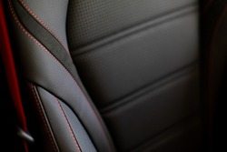 Close up and interior details of modern luxury sport cars. Comfortable leather cockpit seats inside luxury car.