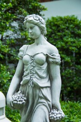 Close up Angel statue in the garden, Fairy statue in the garden, lady in the garden,Beautiful woman statue in the park.