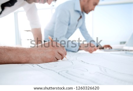 close up.architects make sketches for a new project #1260326620