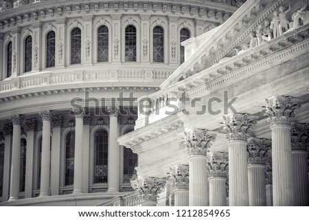 Close-up architectural detail view of the US Capitol Building dome with ornate classical columns of the exterior of the Senate building in Washington DC, USA #1212854965