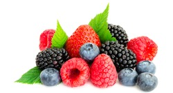 Close-up arrangement mixed, assorted berries including blackberries, strawberry, blueberry, raspberries and fresh leaf isolated on white. Colorful, healthy concept. Black, blue, red, green. Panorama
