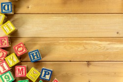Close up arrangement of alphabet on wooden background. Preschool, education, back to school and copy-space concept or other your content.
