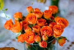 close up arrangement of orange roses