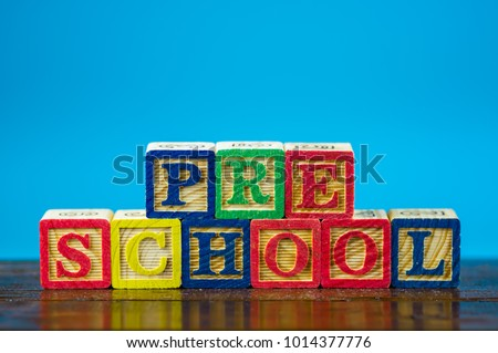 "Close up arrangement of ""Preschool"" alphabet on blue background. Preschool, education and copy-space concept or other your content. #1014377776"