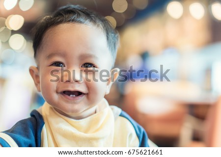 Shutterstock Close up Asian baby face smiling 9 months old.