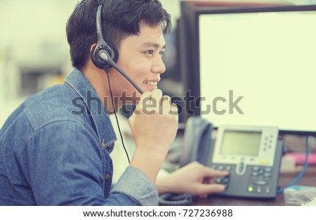 close up asian call center employee man working smiling with service-mind #727236988
