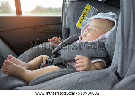 Close Up Asian Cute Newborn Baby Sleeping In Modern Car Seat Child New Born Traveling