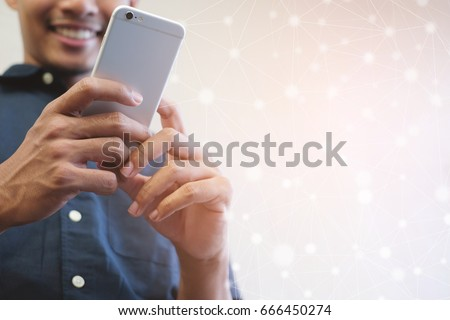 close up asian man hand hold smartphone with IOT connecting line effect concept