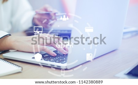 close up asian working woman use credit card for payment on laptop at home office with virtual interface of GDPR (General Data Protection Regulation ) , privacy personal data concept #1142380889