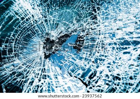 Close-up at broken car windshield. Tint blue