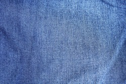 Close up at fade denim jeans texture.Seamless Denim or blue jean background for design.Have copy space or use for creative.Fashion,canvas or designing concept.