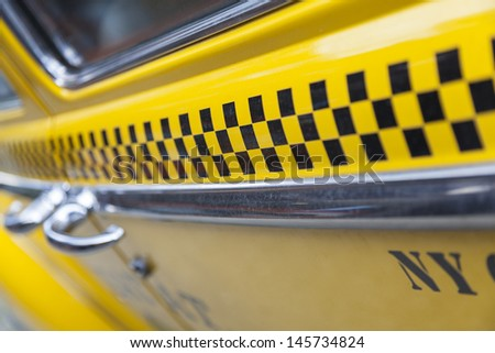 Close up background photograph of the side of New York City Yellow Taxi Cab