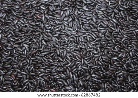 Close up background view of organic black purple rice. - stock photo
