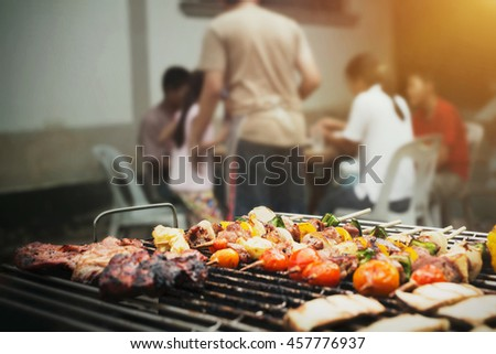 Close up barbecue grills at barbecue party at countryside in holiday time of family and child.