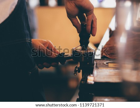 close up barista hand making a cup of coffee.