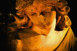 Close up beautiful angel. Ancient stone statue. Horizontal image.