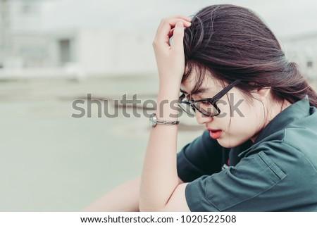 Close up beautiful asian woman wear glasses,Thai girl very pretty,sad woman concept,heartbreak from love,broken heart from boyfriend #1020522508