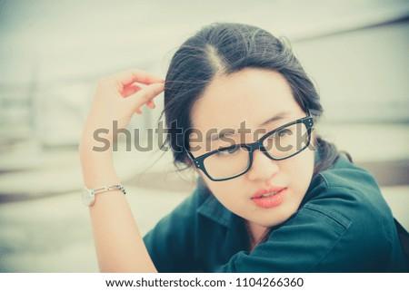 Close up beautiful asian woman wear glasses,Thai girl very pretty,sad woman concept,heartbreak from love,broken heart from boyfriend #1104266360