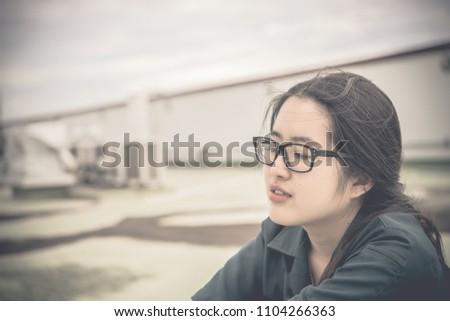 Close up beautiful asian woman wear glasses,Thai girl very pretty,sad woman concept,heartbreak from love,broken heart from boyfriend #1104266363