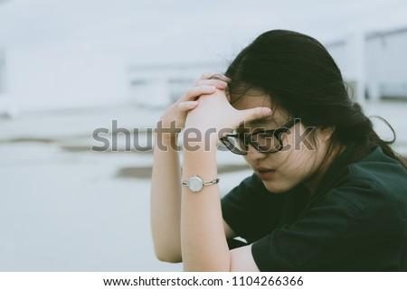 Close up beautiful asian woman wear glasses,Thai girl very pretty,sad woman concept,heartbreak from love,broken heart from boyfriend #1104266366