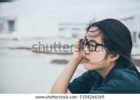 Close up beautiful asian woman wear glasses,Thai girl very pretty,sad woman concept,heartbreak from love,broken heart from boyfriend #1104266369