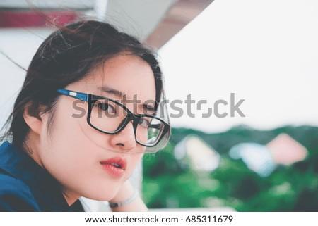 Close up beautiful asian woman wear glasses,Thai girl very pretty,sad woman concept,heartbreak from love,broken heart from boyfriend #685311679