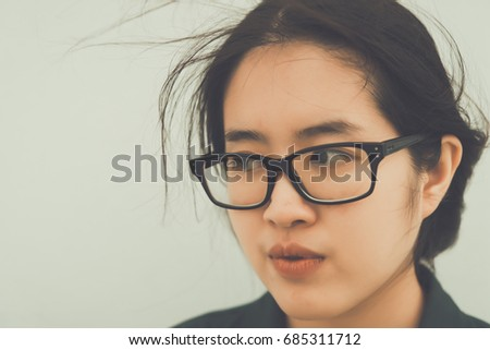Close up beautiful asian woman wear glasses,Thai girl very pretty,sad woman concept,heartbreak from love,broken heart from boyfriend #685311712