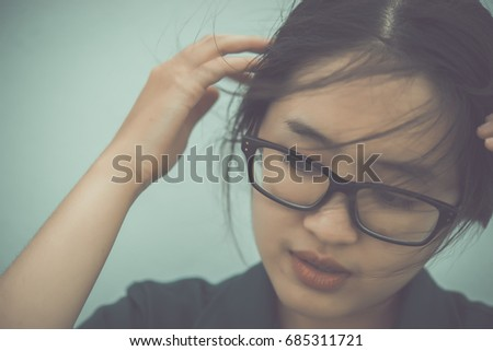Close up beautiful asian woman wear glasses,Thai girl very pretty,sad woman concept,heartbreak from love,broken heart from boyfriend #685311721