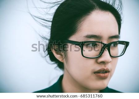 Close up beautiful asian woman wear glasses,Thai girl very pretty,sad woman concept,heartbreak from love,broken heart from boyfriend #685311760