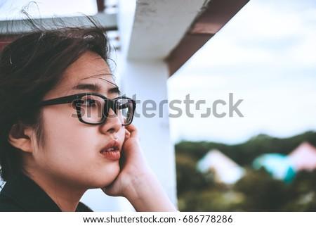 Close up beautiful asian woman wear glasses,Thai girl very pretty,sad woman concept,heartbreak from love,broken heart from boyfriend #686778286