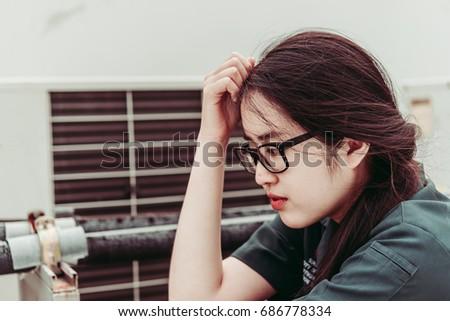 Close up beautiful asian woman wear glasses,Thai girl very pretty,sad woman concept,heartbreak from love,broken heart from boyfriend #686778334