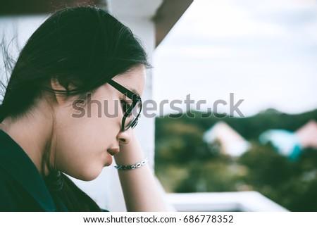 Close up beautiful asian woman wear glasses,Thai girl very pretty,sad woman concept,heartbreak from love,broken heart from boyfriend #686778352