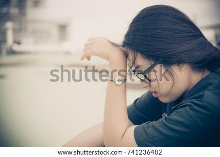 Close up beautiful asian woman wear glasses,Thai girl very pretty,sad woman concept,heartbreak from love,broken heart from boyfriend #741236482