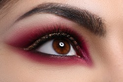 Close-up beautiful female eye decorated with makeup. Quarantine makeup training. Make-up option that is created for special occasion. Fashionable eye for events or for photo shoots