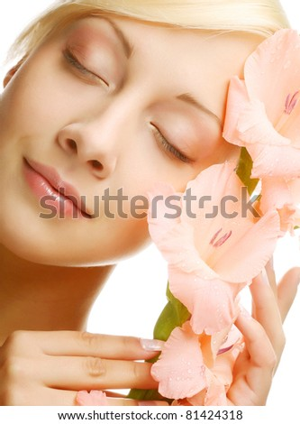 Close-up beautiful fresh face with gladiolus flowers in her hands #81424318