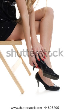 Close up beautiful legs with black shoe, over white background