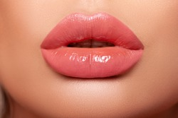 Close-up Beautiful lips. Part of face, young woman close up. Sexy plump lips Nude lipstick. peach color of lipstick on large lips. close-up. - Image