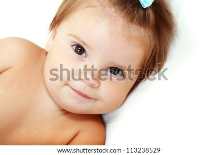 Close up beautiful 10 month old baby girl isolated on white