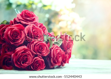 close up beautiful red roses bouquet with glowing light background for valentine day and love theme