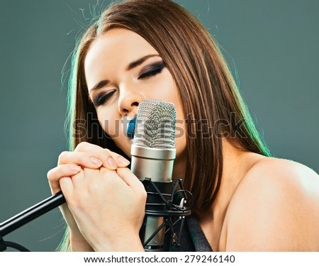 Close up beautiful woman singer portrait. Sound studio.