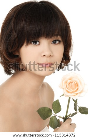 Close up beautiful woman with branch  rose