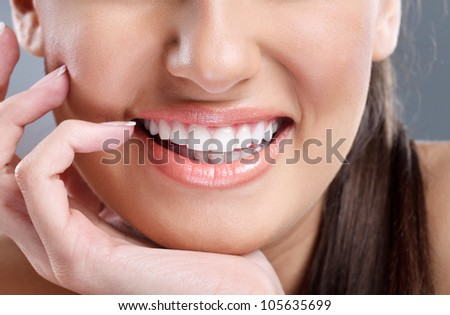 close up beautiful young woman with big healthy smile